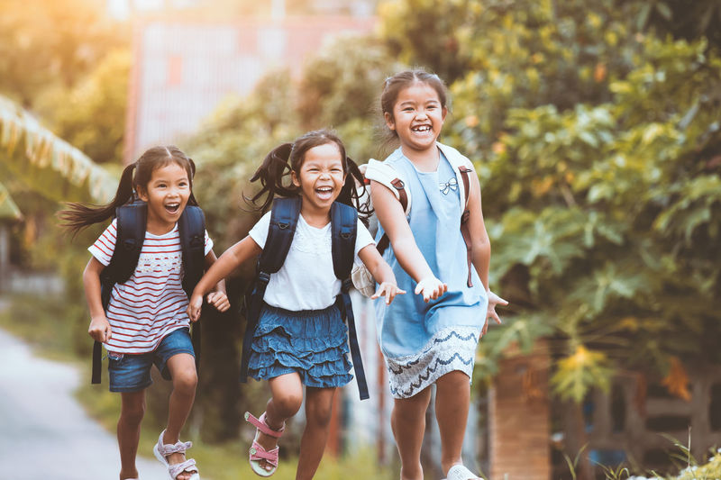 Back to school. Asian pupil kids with backpack running and going to school together with fun and happiness in vintage color tone Asian  Family Happy Running Siblings Sister Student Back To School Backpack Bag Child Cute Generations Girl Holding Kid Knowledge Learn Pupil School Smiling Study Togetherness