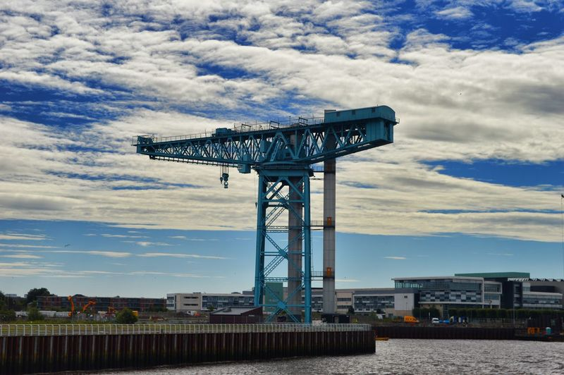 Clydeside River Clyde Scotland Shipbuilding Yard Architecture Building Exterior Built Structure City Cloud - Sky Connection Construction Equipment Construction Industry Crane - Construction Machinery Day Industry Low Angle View Machinery Metal Nature No People Outdoors Shipbuilding Sky Titan Crane Clydebank Water