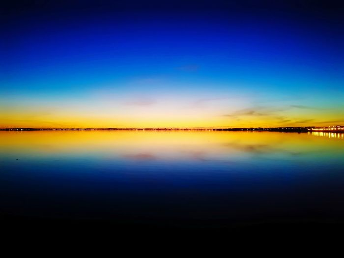 Reflection Sky Scenics Water Outdoors Nature Sunset Tranquility Night Sea Multi Colored Beauty In Nature