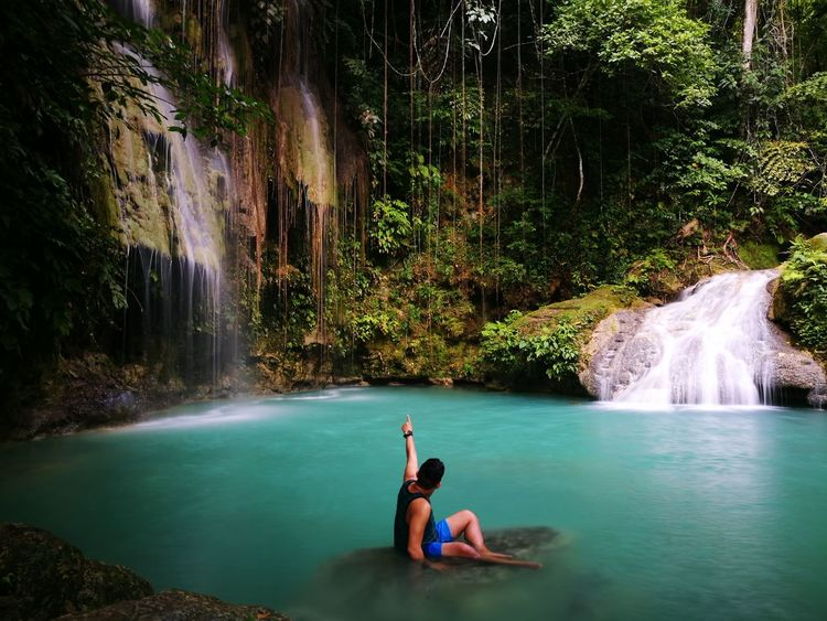 Water Travel Waterfall Swimming People Vacations Adult Beauty In Nature Outdoors One Person Nature Adults Only Beauty Day Adventure Only Women Tree One Woman Only Young Adult Tranquility Eyeem Philippines ChasingWaterfalls CebuMobileShutterbugs CMS Cebuwaterfalls The Week On EyeEm