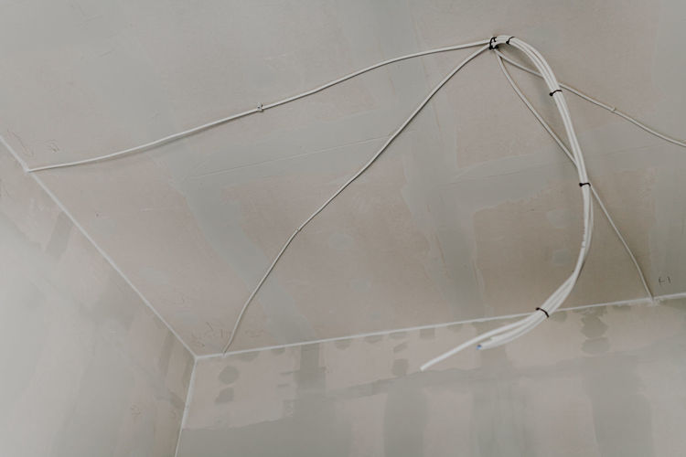 Low angle view of glass hanging from ceiling