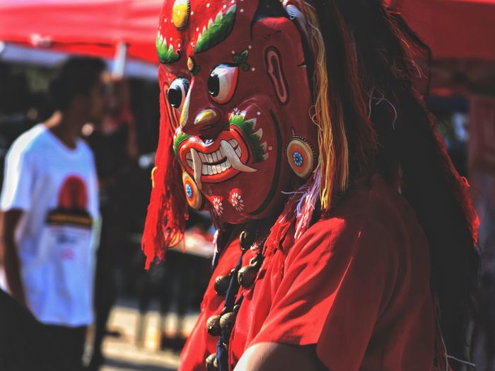 Red Focus On Foreground One Person Portrait Adult Tradition Arts Culture And Entertainment People Performance Outdoors Headshot Day Adults Only Close-up One Man Only Young Adult Only Men Eyeemnepal Demon Mask Evil Lakhe Culture Tradition Local