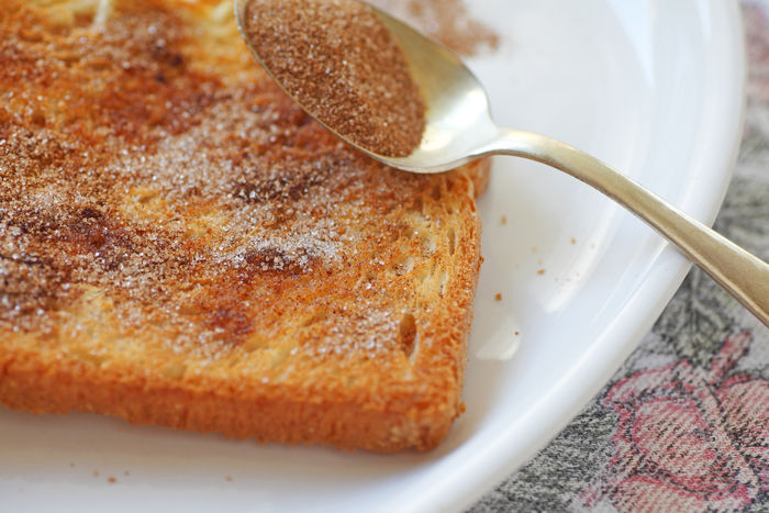 Cinnamon toast with spoon Breakfast Home Cooking Homemade Food Natural Light Snack Studio Textures Bread Cinnamon Sugar Cinnamon Toast Close-up Day Fabric Food Freshness Indoors  No People Plate Ready-to-eat Spice Sweet Food Sweet Foods
