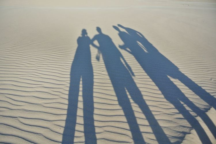 Shadow of people on sand