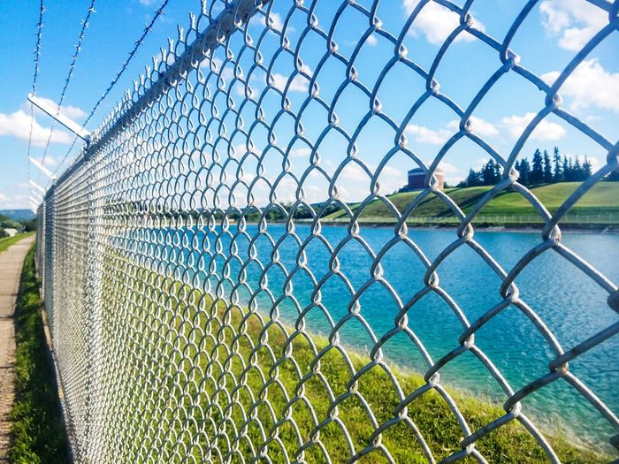 Chainlink Fence Nature Day Water No People Metal Outdoors Sky Grass Samsung Galaxy S7 Reservoir View Reservoir Syracuse
