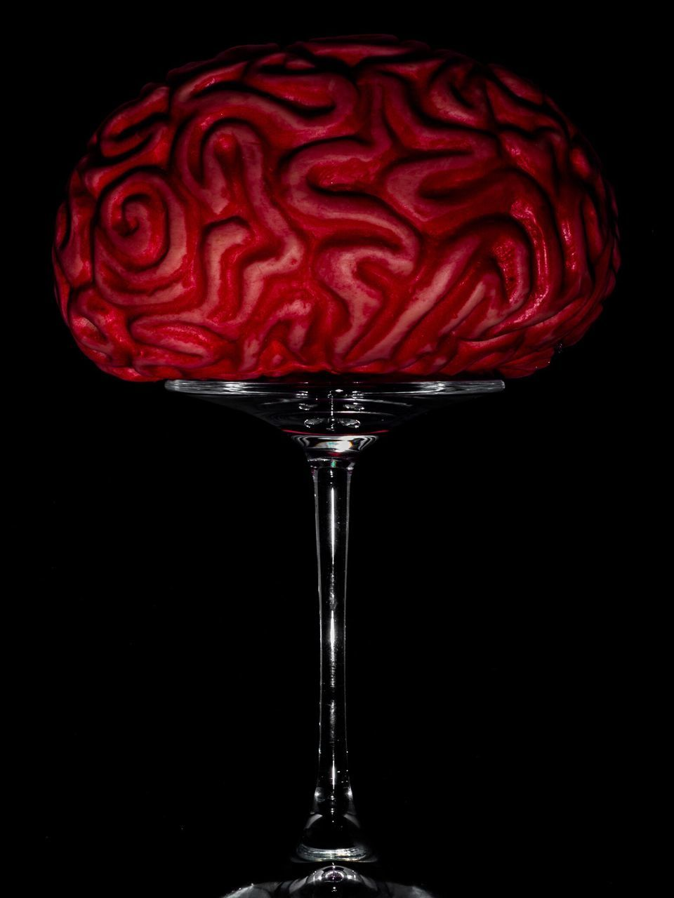 Close-Up Of Brain On Glass Against Black Background
