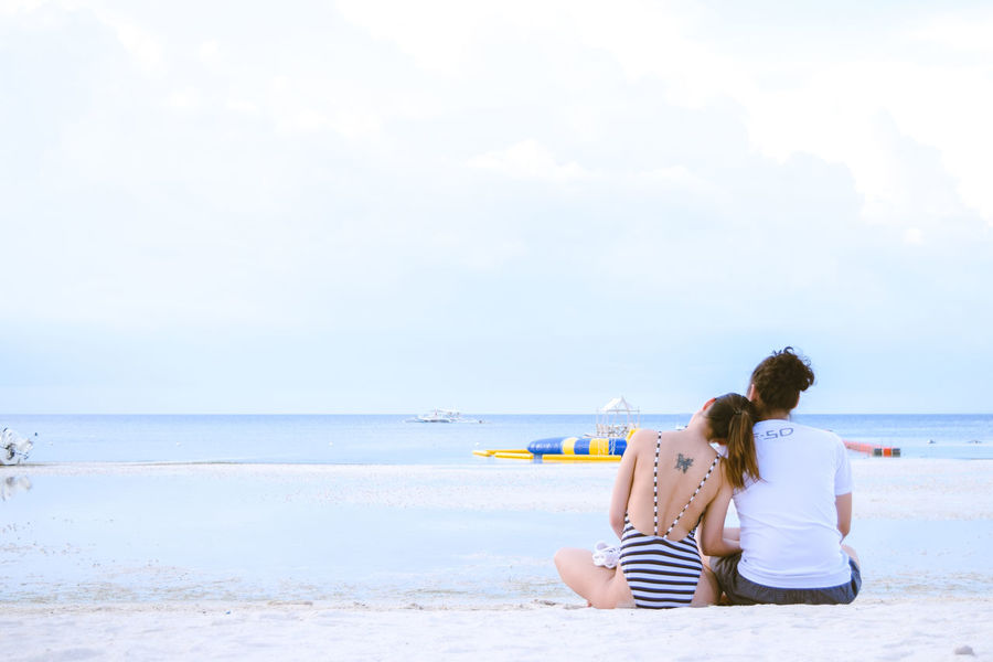 Sea Beach Horizon Over Water Water Sand Leisure Activity Shore Casual Clothing Lifestyles Tranquil Scene Sitting Sky Rear View Tranquility Scenics Relaxation Beauty In Nature Summer Vacations Philippines Bohol Bellevue Eyeem Philippines Couple