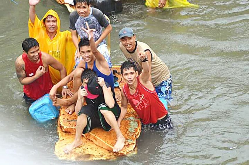 Floods Funny Moments Struggle For Life Enjoying Life People Photography Stormy Weather Philippines Photos it was a stormy morning when I look outside where I live and saw this young people try to earn some money using old styrofoam or old bed to make a small banca and transport people to avoid get wet from floods while going to work... it is a usual scenario once heavy storm strikes Manila