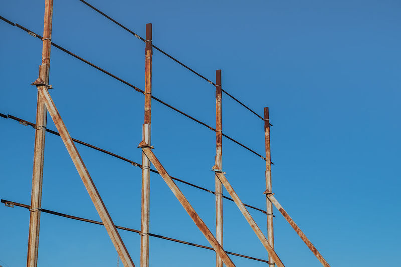rusty iron in the blue sky Steel Tower  Architecture Blue Blue Sky Clear Sky Construction Frame Construction Site Day Low Angle View Metal No People Outdoors Rusty Rusty Steel Rusty Things Sky Steel Structure