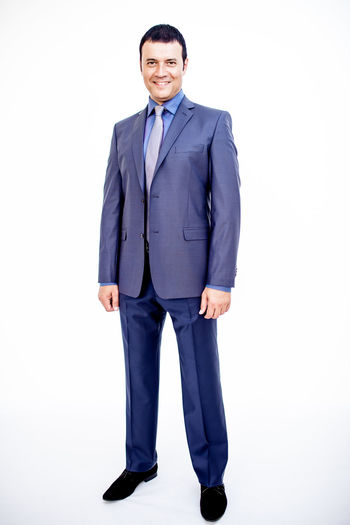 Man in classic suit on the white background. Studio shot. Business Business Stories Classic Man Standing Suit Blue Business Finance And Industry Business Person Businessman Catalogue Clothes Full Frame Full Length Men One Man One Man Only One Person Shoes Smile Smiling Style Tie White White Background