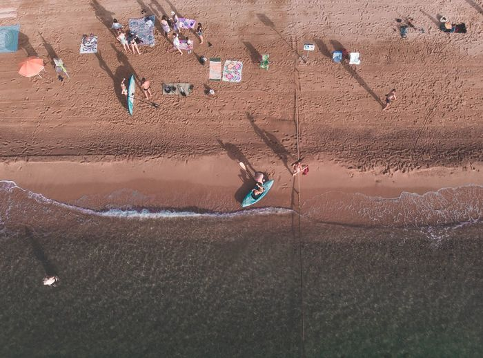 Aerial view of people enjoying a summer morning on the beach