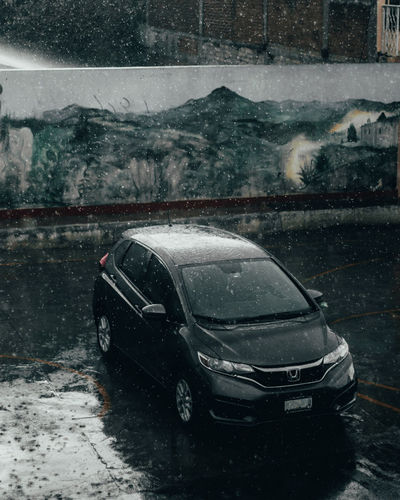 Car in puddle during rainy season
