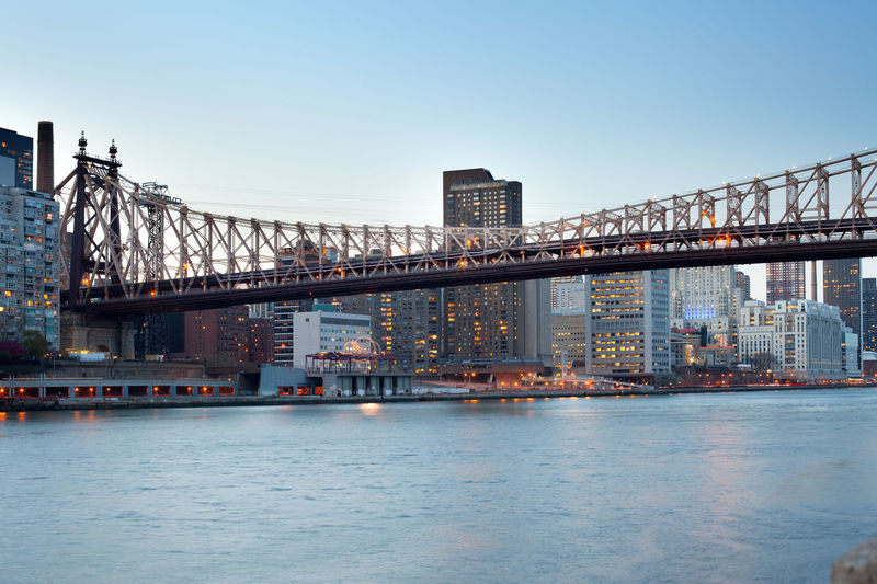 Queensboro Bridge over the East River and Upper East Side, Manhattan, New York City, NY, USA City Cityscape East River Manhattan New York New York City Queensboro Bridge Skyline USA Upper East Side Architecture Bridge Buildings Connection Dusk Illuminated Night River Waterfront