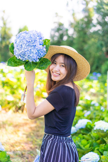 hydrangea garden Portrait Hydrangea Hydrangea Flower Hydrangea In Bloom Hydrangea Bush Flower Asian  Garden Hat Cute Women One Person Smiling Looking At Camera Plant Clothing Real People Standing Three Quarter Length Flowering Plant Nature Young Women Casual Clothing Lifestyles Happiness Young Adult Hairstyle Fashion Beautiful Woman Hair Sun Hat Outdoors