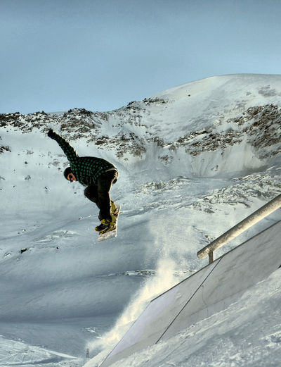 Low angle view of snowboarding