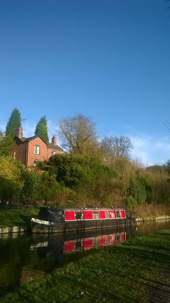 Barge Beauty In Nature Blue Canal Canal Boat Canal Side Grass Landscape Mooring Narrow Boat Outdoors Red Refelections Tranquility Tree British Waterways Working Boat