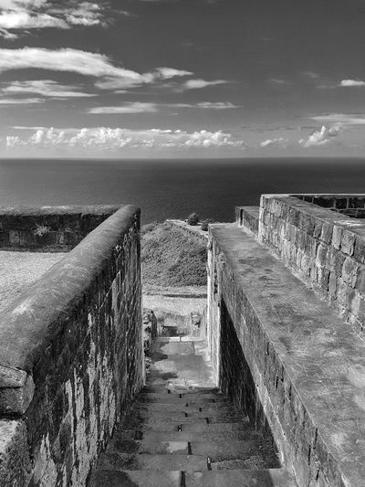 An Eye For Travel EyeEmNewHere St. Kitts Architecture Beauty In Nature Brimstone Hill Built Structure Carribean Cloud - Sky Day Groyne Horizon Over Water Nature No People Outdoors Railing Scenics Sea Sky Tranquil Scene Tranquility Water Black And White Friday