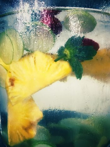 Infused drink for breakfast Pineapple Slices Yellow Water Multi Colored Close-up Lime SLICE Drink Fruit