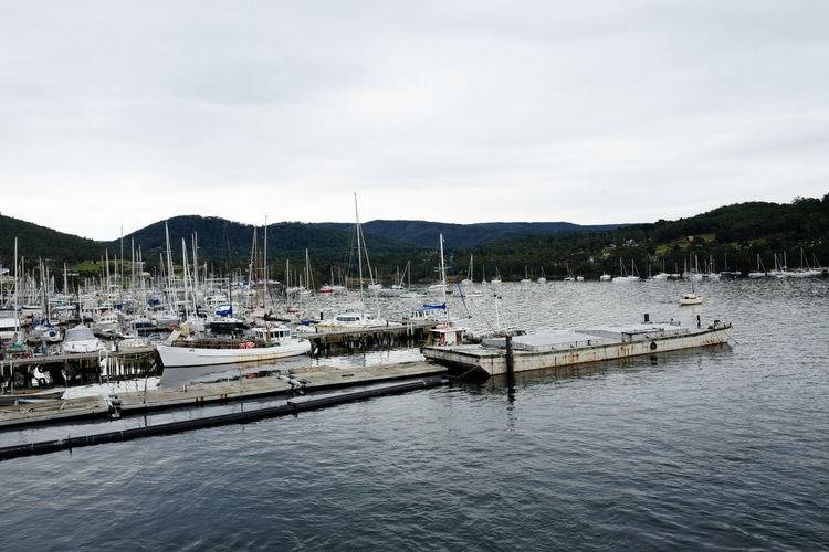 Shot in Tasmania, Australia. Beauty In Nature Cloud - Sky Day Harbor Lake Mast Mode Of Transport Moored Mountain Nature Nautical Vessel No People Outdoors Sailboat Scenics Sky Tranquility Transportation Travel Destinations Tree Water Yacht