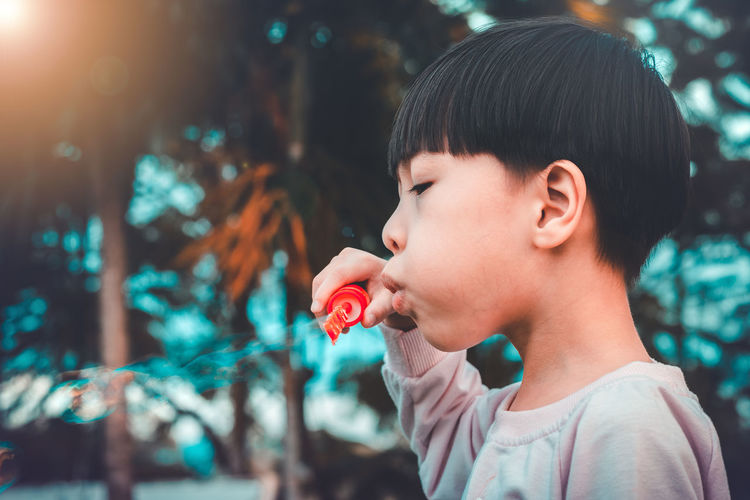 Playing Outdoors Green Nature Leisure Activity Childhood Boy Kid Park Cute Little Bubble Bubbles Beauty Playful Child Happy Joy Happiness Summer Young Blowing Fun Soap Beautiful Innocence Holding Lifestyles Portrait Boys Looking Close-up Men Headshot Real People