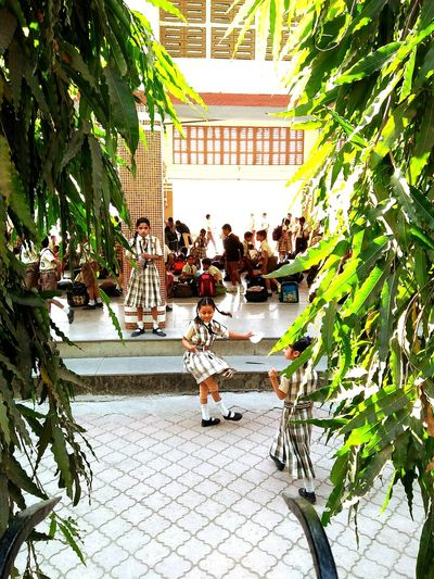 kids playing in school Kids Kids Playing Kids In Motion Kids Having Fun Kids Playing In School Kids Playing In School Uniform School Childrens School Girl Kids In Motion Playing In School Architecture Built Structure Real People Building Exterior Large Group Of People Plant