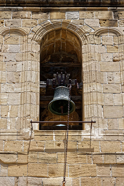 An old tower bell in Nicosia, Cyprus. Cyprus Nicosia Old Town Arch Architecture Belief Bell Brick Building Building Exterior Built Structure Day Electric Lamp History Low Angle View No People Old Old Ruin Ornate Outdoors Religion Spirituality Stone Wall The Past Tower Bell Wall Wall - Building Feature Window