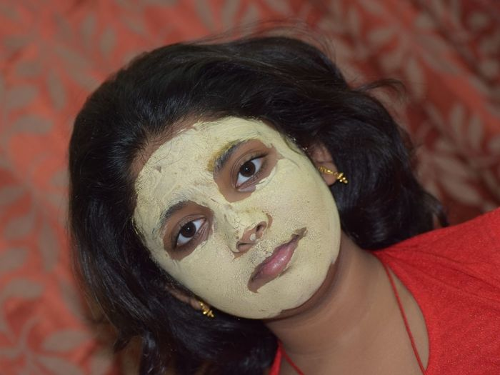 Portrait of girl wearing facial mask