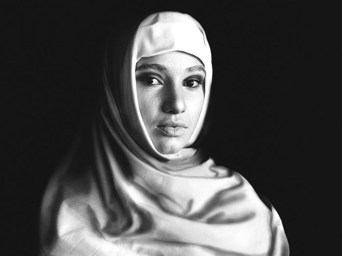 She Portrait Headshot Black Background Studio Shot One Person Women Front View Looking At Camera Indoors  Hijab Headscarf Young Adult Adult Young Women Real People Traditional Clothing Lifestyles Veil Human Face