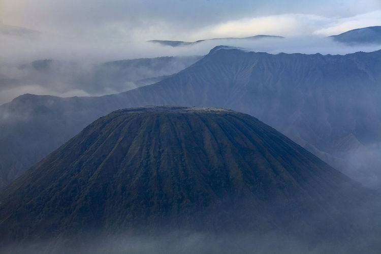 Volcanic landscape against sky