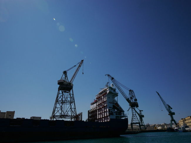 Impressions from island Malta Malta Mediterranean  Clear Sky Commercial Dock Crane Crane - Construction Machinery Day Drilling Rig Low Angle View Malta♥ Nature Nautical Vessel No People Outdoors Sky Water Waterfront