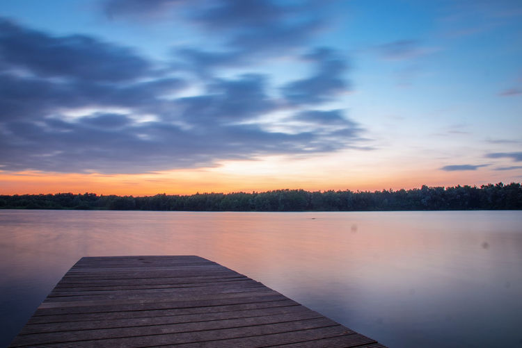 Long Exposure The Week on EyeEm In Thoughts With You Genießen Beauty In Nature Idyllic Tranquility Tranquil Scene Heaven Clouds And Sky Beautiful Scenery Cloud - Sky Scenics Scenery Abschalten Calm Water Tree Sunset Blue Lake Reflection Beauty Sky Horizon Over Water Pier