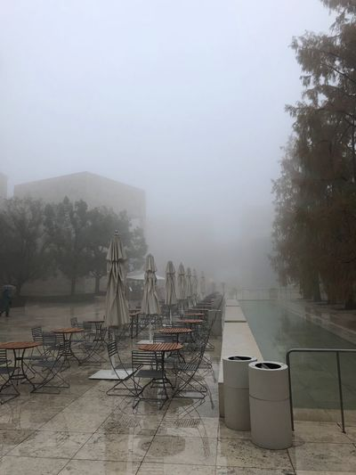 Scenic view of tables and chairs in mist