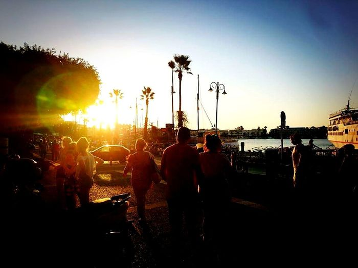 Greece Harbour Tree City Sunset Togetherness Silhouette Sunlight Amusement Park Sky Sunbeam Lens Flare