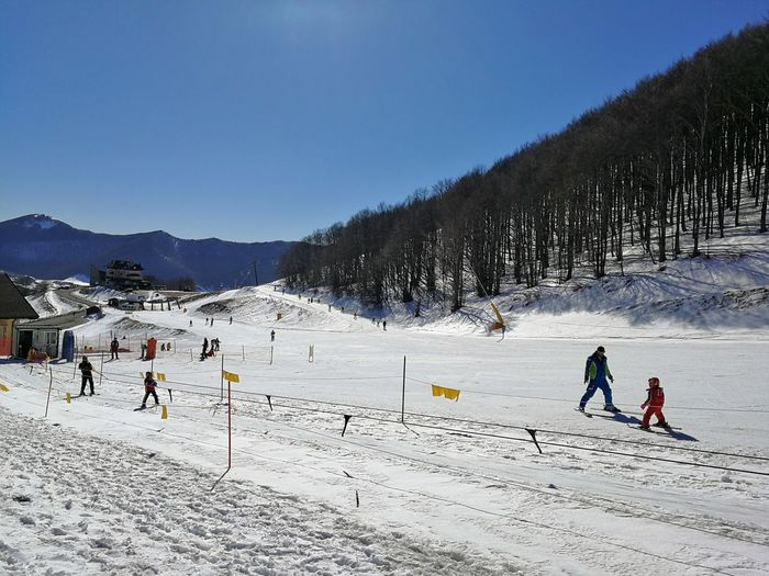 Cold Temperature Snow Winter Sport Mountain Real People Leisure Activity Sky Winter Sport Lifestyles Group Of People Nature Scenics - Nature Land Vacations People Beauty In Nature Day Field Mountain Range Ski-wear Outdoors Snowcapped Mountain Ski Run Roccaraso