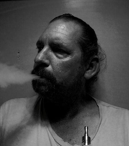 Close-Up Of Man Smoking Against Wall