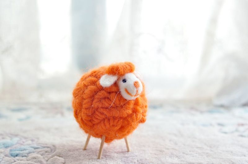 Close-Up Of Figurine Sheep Made Of Woolen Ball