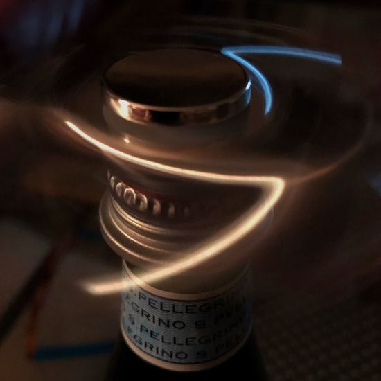 Spinner Toy On Pelligrino Bottle No People Indoors  Close-up Day Reflection Centrifugal Force