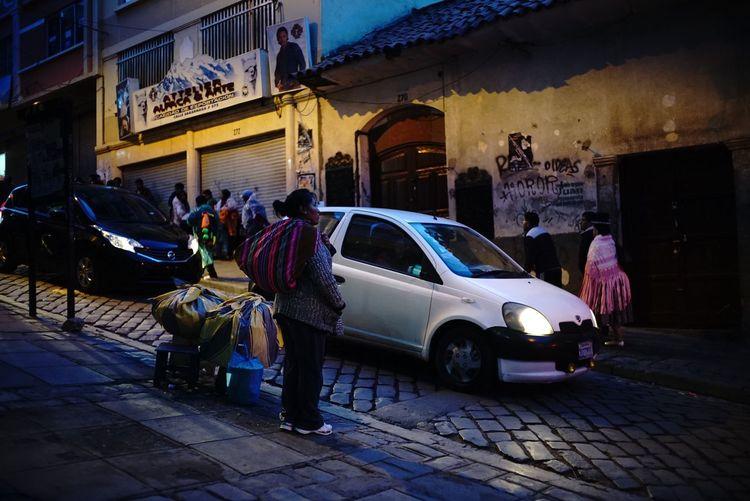 People on street at night