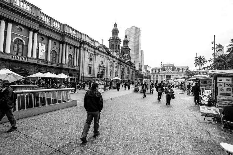 Walking around the Plaza de Armas, Santiago, Chile Travelling Photography Travel Destinations Travelling Chile Architecture Building Exterior Built Structure City Sky Building Real People Lifestyles Travel Walking Street #urbanana: The Urban Playground