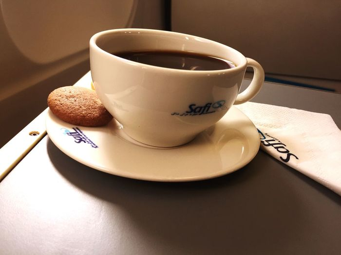 Coffee in a plane. Inflight EyeEm Selects Mug Cup Drink Food And Drink Indoors  Table Coffee Cup Crockery Coffee Hot Drink Still Life Coffee - Drink No People Saucer Freshness Refreshment