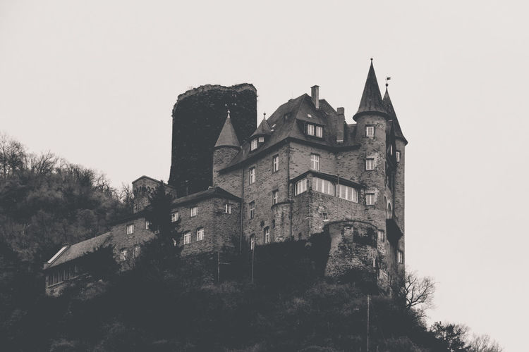 """This is the """"Burg Katz"""" (""""castle cat"""") in St. Goarshausen (Germany). I like its small pointy towers and its location at the hillside. Unfortunately, this castle cannot be entered by tourists. Architecture Black And White Building Building Exterior Built Structure Burg Burg Katz Castle Château Clear Sky Day Fortress Hillside Historical Building Historical Sights History Manor House Mountainside Old Outdoors Slope Stately Home Stronghold The Past Towers"""