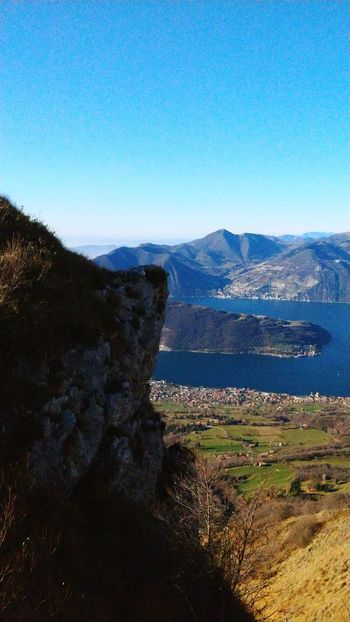 Hey, they're opening the curtain! Iseo Lake Iseo Lake Iseo Rocks Rock Formation Blue Nature Water Day Mountain Sky No People Outdoors Scenics Landscape Beauty In Nature
