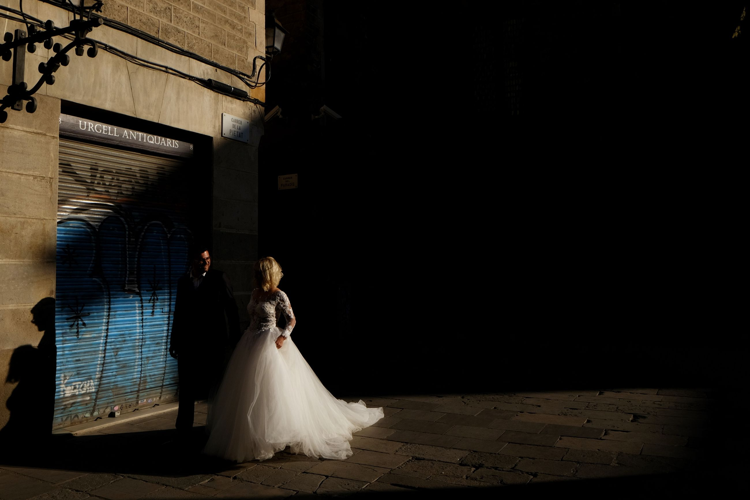 real people, wedding, bride, men, wedding dress, women, built structure, love, groom, togetherness, walking, bridegroom, celebration, full length, night, life events, architecture, indoors, building exterior, well-dressed, people