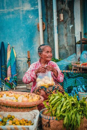 One Person Multi Colored Outdoors Day People Photography Canon Wanderlust Adventure Java Travel Photography People Photography People Watching Portraits Looking At Camera Traveling Photograph Culture; Portrait Portrait Photography Colours Of Life Colourfull Travel Destinations Market Vendor INDONESIA Visual Creativity