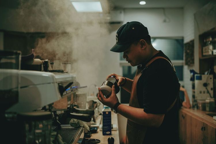 coffee maker Barista Coffee Shop Workshop Working Instrument Maker Expertise Standing Making Concentration Side View Preparation  Coffee Maker Cafe Latte Cappuccino The Photojournalist - 2019 EyeEm Awards