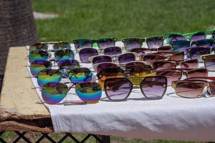 Summer Multi Colored Glasses Close-up No People Sunglasses Day Glass - Material Large Group Of Objects Focus On Foreground In A Row Choice Still Life Selective Focus Outdoors Fashion Variation Transparent Personal Accessory Summer