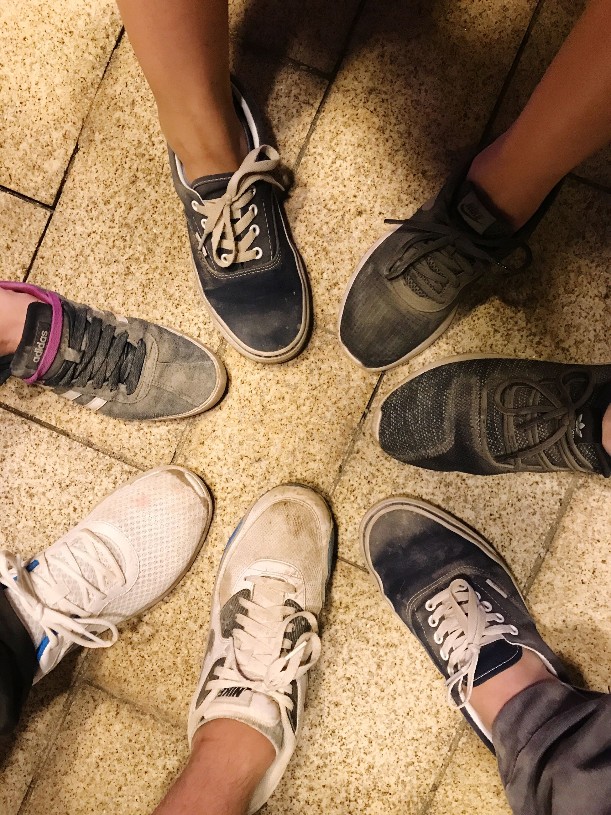 shoe, human leg, human body part, low section, standing, real people, men, high angle view, lifestyles, one person, sandal, outdoors, friendship, day, people, adult, adults only