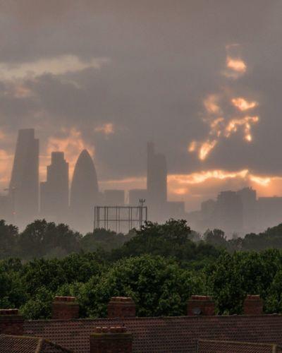 Sunset and skyline through a rain curtain Cityscapes Cityscape Skyline London_only London Londonlife City View  Urbanphotography Taking Photos Sunset Rain Showcase June