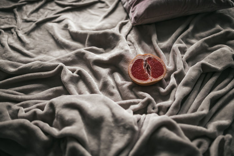 High angle view of fruits on bed
