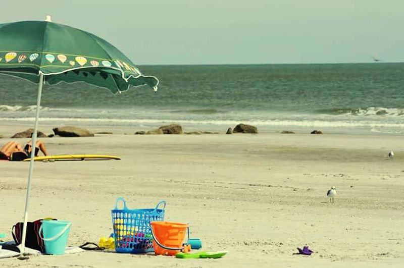 Beach Life Getting A Tan Sandcastles Enjoying The Sun FamilyTime Colorful Playful